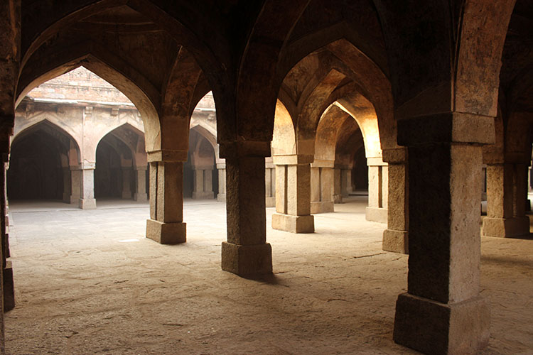 The deserted colonnades of the Khirki mosque